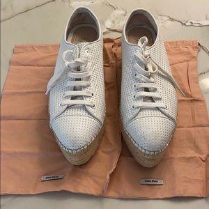 Miu Miu white leather wedge sneakers.